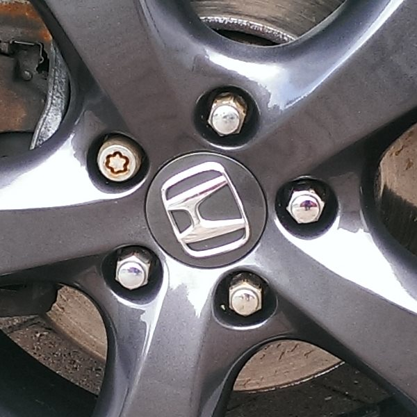 Alloy wheel locking nuts removed