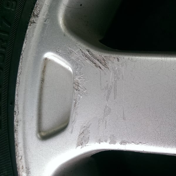 Alloy wheel scuffs and scrapes repaired